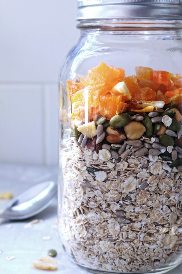 Mason jar muesli with dried fruit, oats and seeds side view