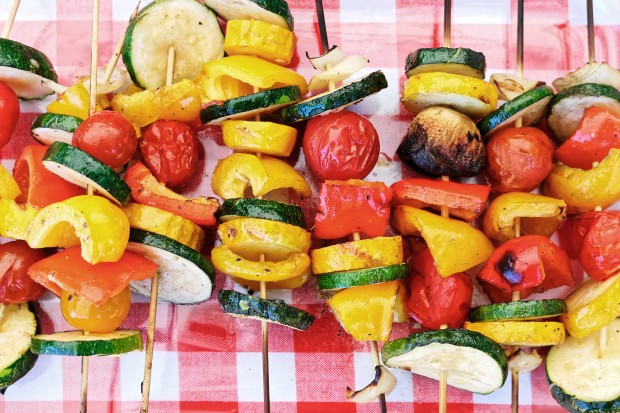 Cooked vegetable vegan gluten free skewer kebab on picnic table