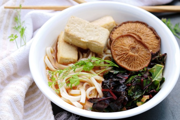 Vegan vegetarian ramen with broth soup noodles mushrooms tofu and cooked greens